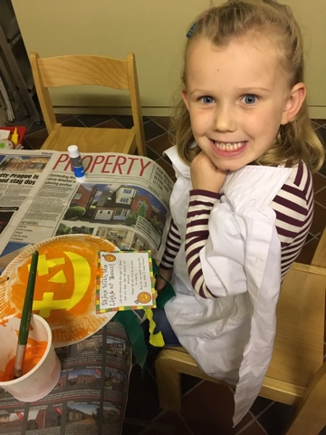 Painting our special pumpkin.