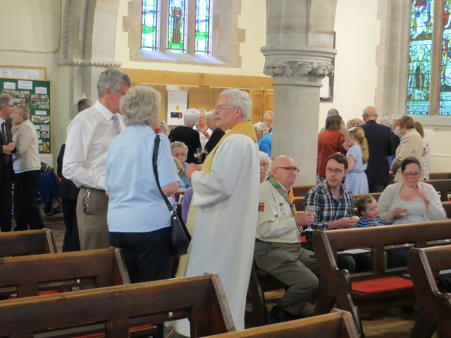 The congregation enjoying the cakes and prosecco after the service