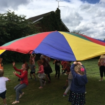 Playing with the parachute while talking about the colours in Joseph's coat.